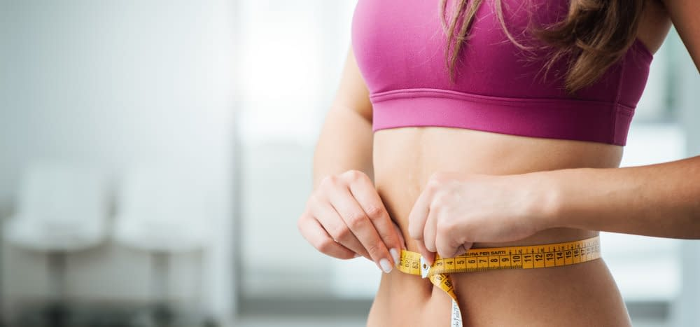 woman tape measure waist
