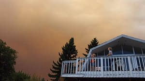 smoky skies house people on porch