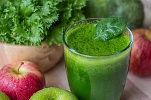 green drink with green vegetables and apples