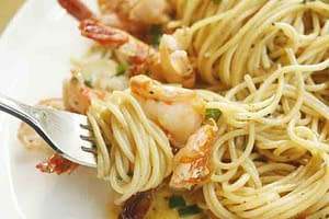 pasta shrimp and fork