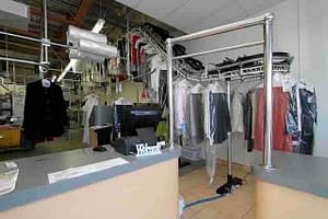 clothes hanging in a dry cleaning shop