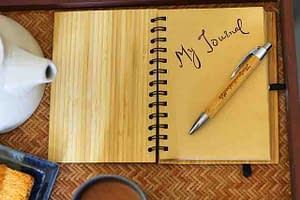 journal tea and pen