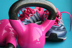 pink kettleballs and sneakers