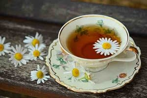 tea cup with tea and flowers