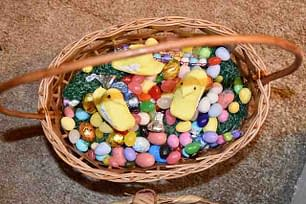 basket with sugar candies and plastic grass