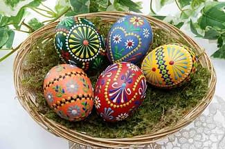 beautiful decorated eggs in natural basket