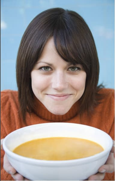lady eating wild mushroom flavor soup