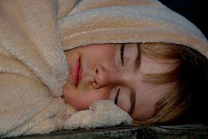 child sleeping in blanket