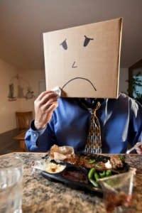 unhappy man box on head
