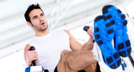 man on rowing machine at gym