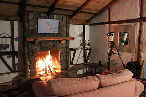 wood burning fireplace cozy indoors couch and telescope