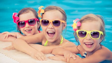 3 children in swimming pool